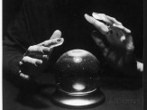 a-spooky-photograph-of-a-crystal-ball-and-a-woman-s-hands